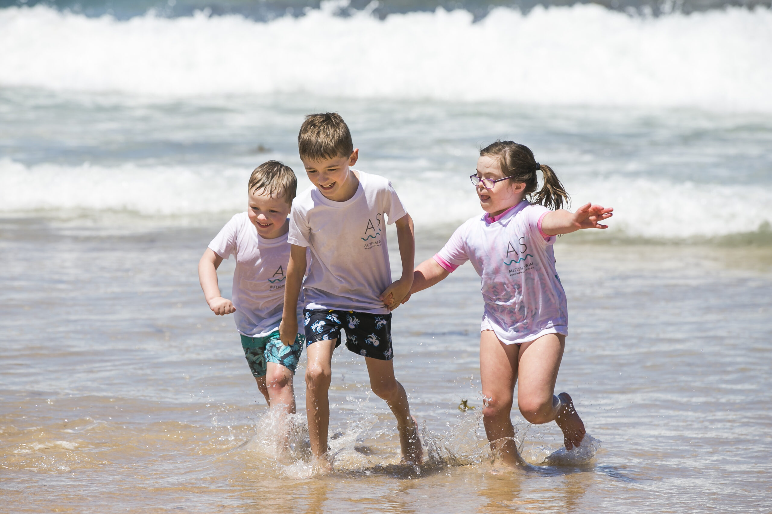 Coogee Dippers kids Jasper Getts, 4, Harley Getts, 8, and Cate Smith, 8. Picture: Dylan Robinson