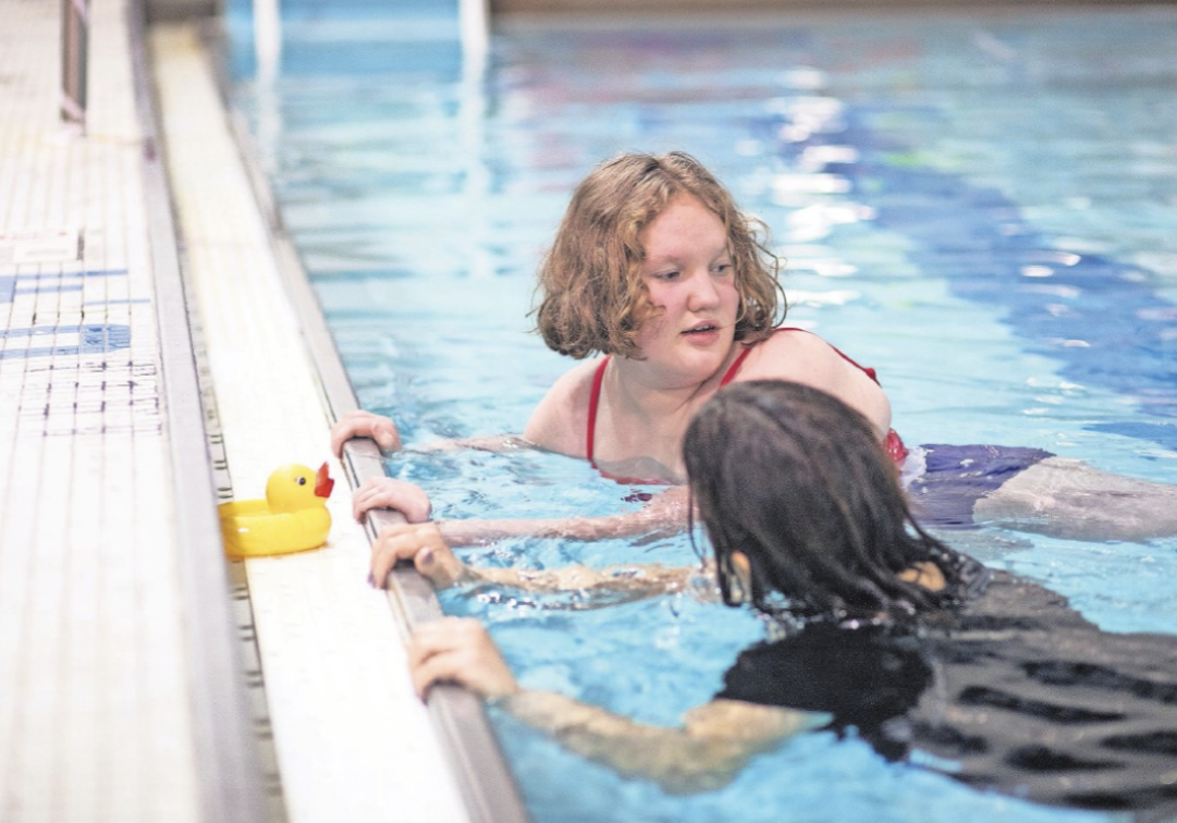 Eden Facer, 13, is learning water safety with Erica Tortorella, and can now feel comfortable in the deep end. PHOTO BY ALLYSE PULLIAM
